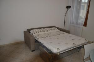 A bed or beds in a room at Calle Michelangelo