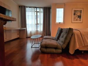 Zona de estar de New Concept Apartments- STGO Centro