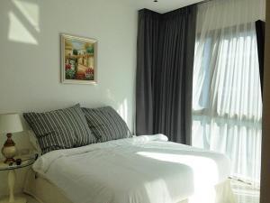 Ein Bett oder Betten in einem Zimmer der Unterkunft Condominium The Sanctuary of Truth