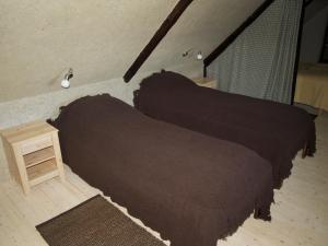Voodi või voodid majutusasutuse Aaduaida Holiday House toas