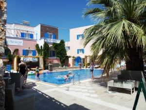 The swimming pool at or near Atalos Suites