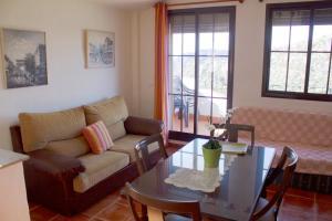 A seating area at Apartamentos Rurales Sierra Alta