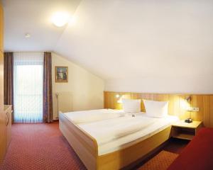 Ein Bett oder Betten in einem Zimmer der Unterkunft Appartementhaus Josef