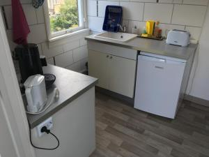 A kitchen or kitchenette at Yokistay