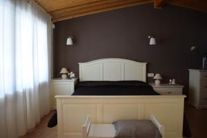 A bed or beds in a room at La Parcela