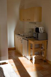 Küche/Küchenzeile in der Unterkunft Landhof Potsdam Ferienzimmer