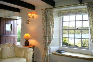 A seating area at Waterside Holiday Cottages