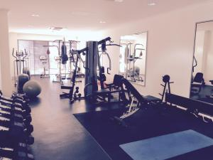 The fitness center and/or fitness facilities at Arcus City Apartment
