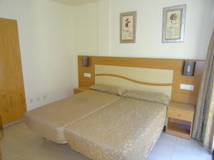 Ein Bett oder Betten in einem Zimmer der Unterkunft Apartamentos Selvapark