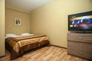 A bed or beds in a room at Kvart-Hotel Atrium Palace