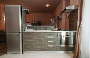 A kitchen or kitchenette at Ana Apartment
