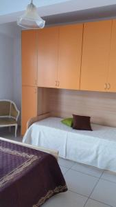 A bed or beds in a room at Casa Tina
