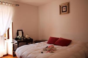 Letto o letti in una camera di House La Quiete by Holiday World