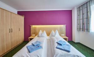 מיטה או מיטות בחדר ב-Haus Birke by HolidayFlats24