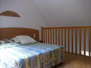 Un ou plusieurs lits dans un hébergement de l'établissement Résidence La Peyrie