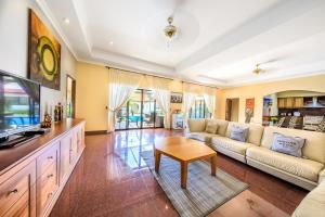 A seating area at View Talay Pool Villa Pattaya
