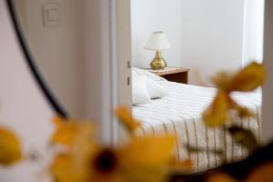 Letto o letti in una camera di Casa Fertilia