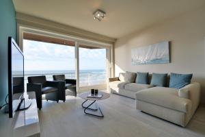 A seating area at Residentie Scorpio B1