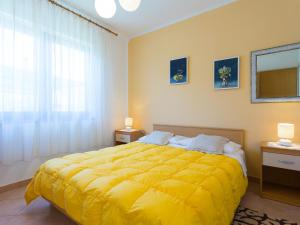 A bed or beds in a room at Apartments Graziella