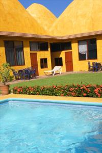 The swimming pool at or near Las Casitas