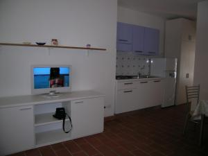 A kitchen or kitchenette at Appartamenti Solaris