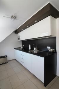 Kuchnia lub aneks kuchenny w obiekcie Apartament Meander