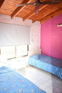 A bed or beds in a room at Grupo Costanera Depto Santa Ana