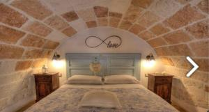 A bed or beds in a room at B&B Casa Fiore