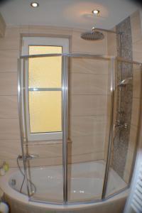 Ein Badezimmer in der Unterkunft Apartment Avenzio