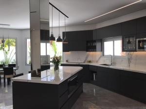 A kitchen or kitchenette at Villa Gardenya