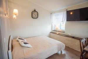 Voodi või voodid majutusasutuse Lapmanni apartments toas