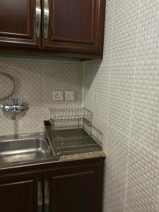 A kitchen or kitchenette at Red Tower Furnished Apartments