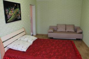 Кровать или кровати в номере Apartment on Stroiteley