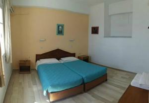A bed or beds in a room at Litharia Apartments