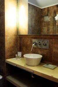 A bathroom at Apart Hotel Via 51
