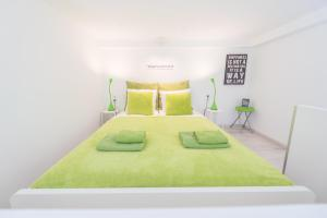 A bed or beds in a room at happy home Budapest FOX