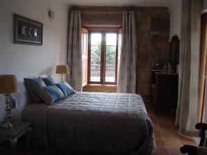 Uma cama ou camas num quarto em Casa de Campo Patio do Avo