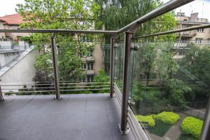 En balkon eller terrasse på Apartments Kremer I Cracow