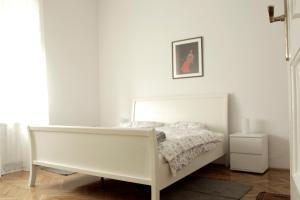 Posteľ alebo postele v izbe v ubytovaní Cela Apartment