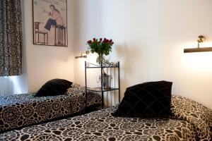 Lova arba lovos apgyvendinimo įstaigoje Pergamin Apartments