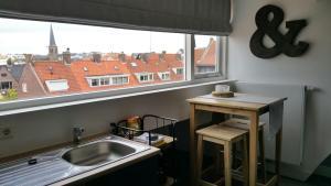 Küche/Küchenzeile in der Unterkunft No.8