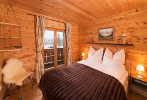 Ein Bett oder Betten in einem Zimmer der Unterkunft Mein Chalet