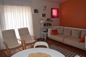 A seating area at Casa da Praia | Luz Beach
