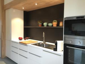 Cuisine ou kitchenette dans l'établissement Source du Suary