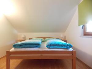 Postelja oz. postelje v sobi nastanitve Hiša Nataša