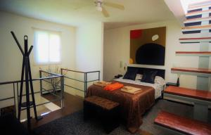 A bed or beds in a room at Casa Naaj Apartments