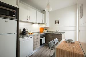 A cozinha ou cozinha compacta de Aveiro Train Flat