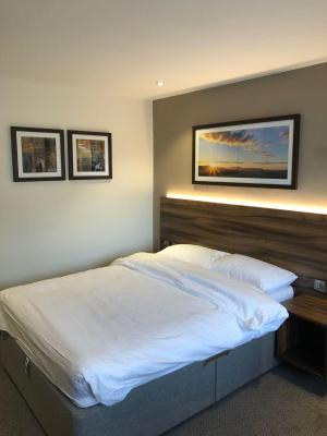 A bed or beds in a room at Rivington Lodge