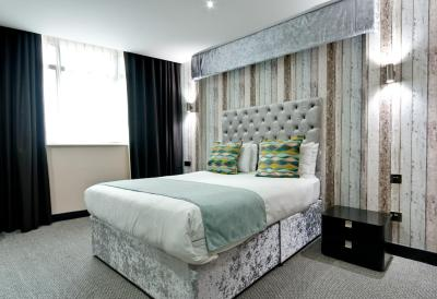 A bed or beds in a room at Print Works Hotel