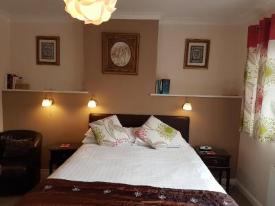 A bed or beds in a room at Penryn Guest House